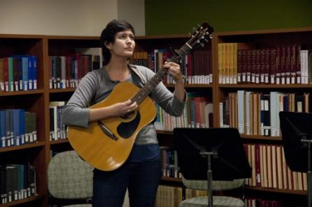 Student performing at Performing Arts Library Open Mic Lunch event.