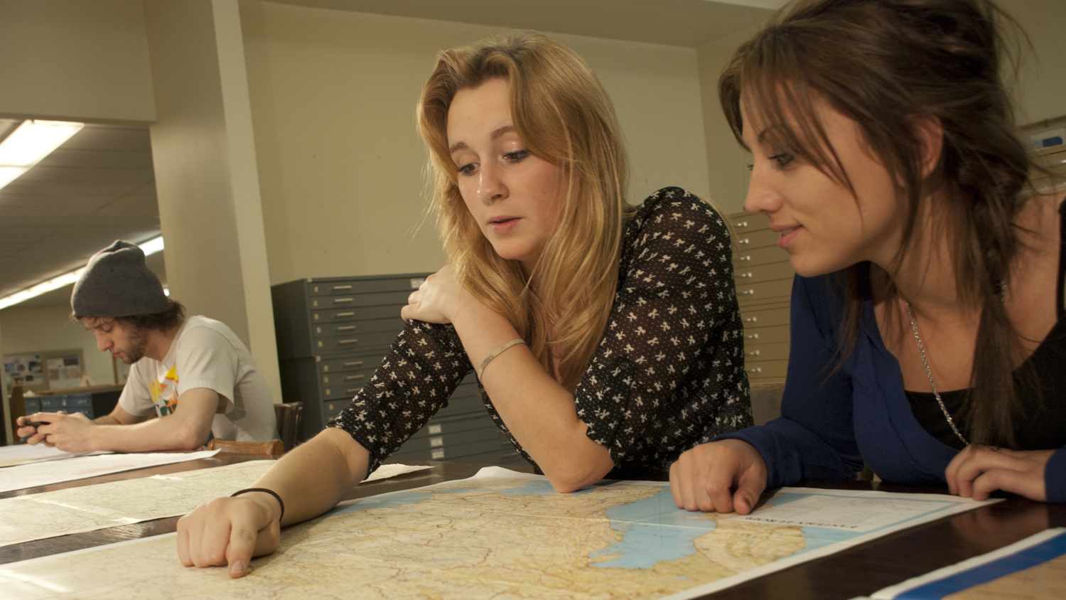 Students studying a map