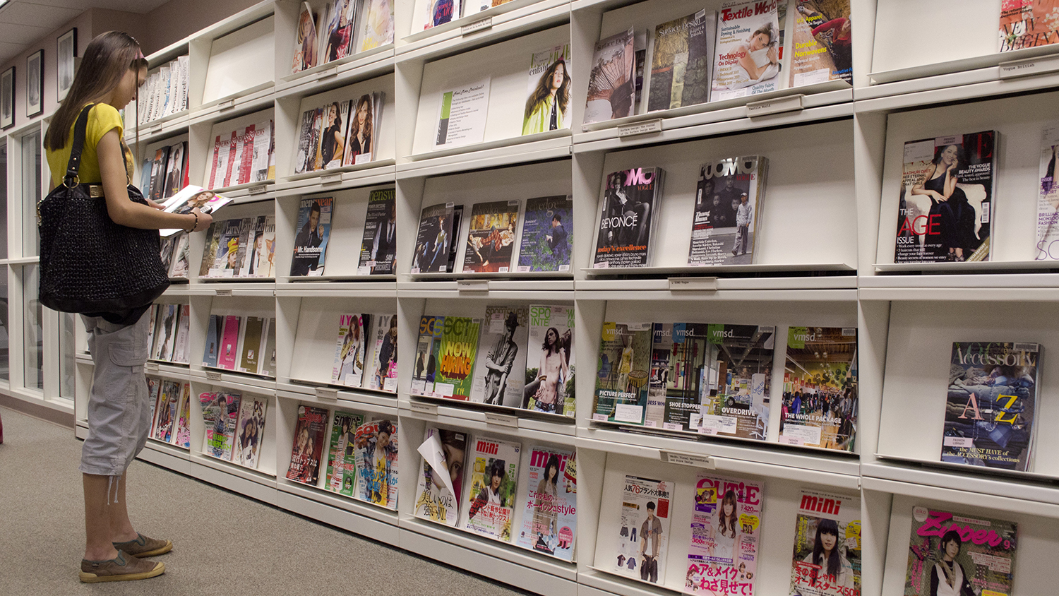 Student Looking at Fashion Magazines