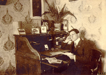 A.J. Trory at desk in bakery [March 1901]