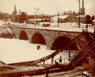 Photograph of Ice Skaters under Main St. Bridge in Kent, Ohio [ca.1905]