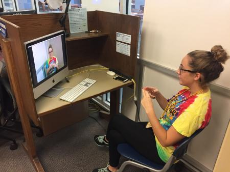 A student uses the American Sign Language Recording Station in the Student Multimedia Studio