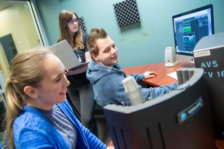 students work on a group project in one of the editing suites in the Student Multimedia Studio