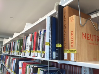 A shelf of books resides in the Architecture Library